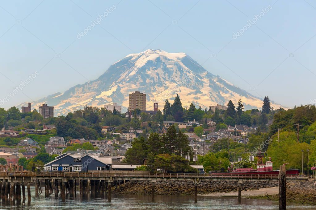 Mount Rainier over the city of Tacoma Washington waterfront on a clear blue sky sunny day