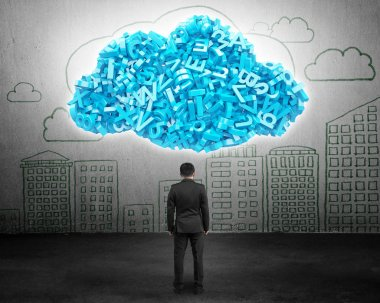 Big data. Businessman facing blue characters in cloud shape.