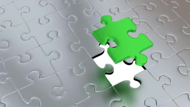 Rotation around One big Green Puzzle Piece above many others Gray Pieces