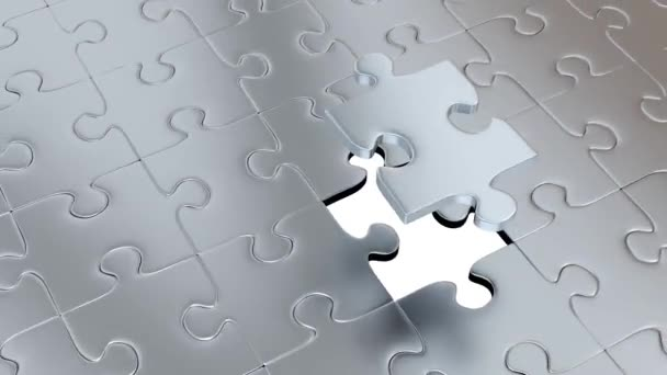 Rotation around One big Silver Puzzle Piece above many others Gray Pieces