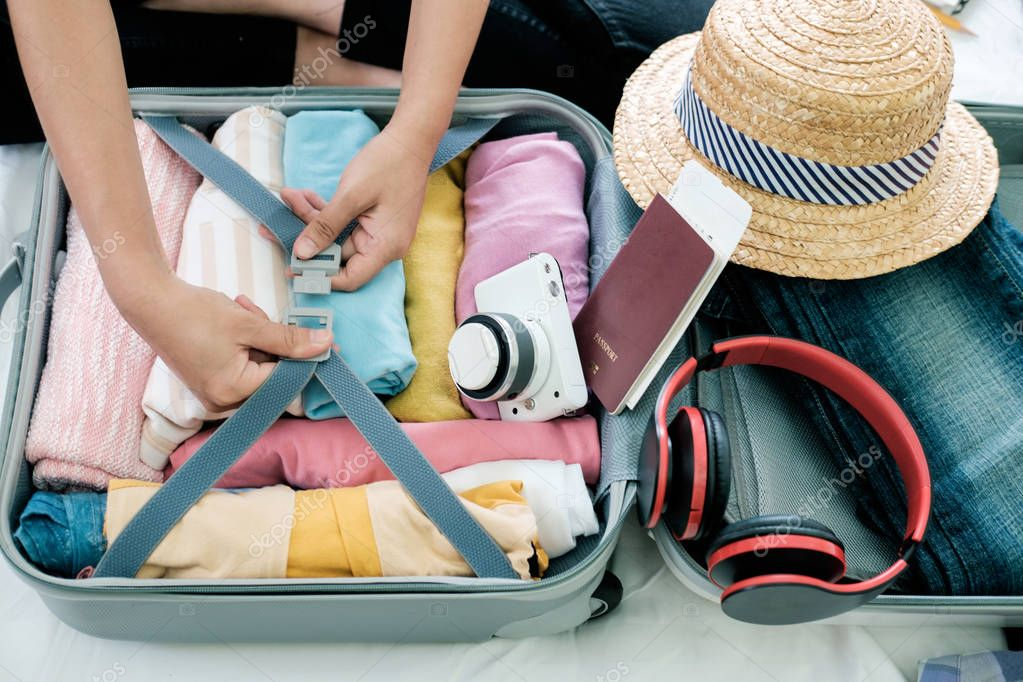 Preparation for vacation or travel. Packing his clothes and stuff into large opened suitcase that almost already full. stock vector