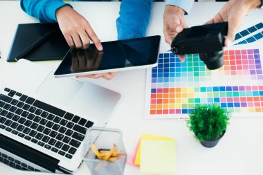 Graphic designer and Photographer working on computer and used graphics tablet stock vector