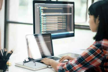 Programmer and UX UI designer working in a software development and coding technologies. Mobile and website design and programing development technology