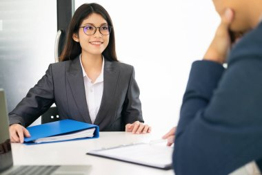 Business situation, job interview concept. Confident businessman in a job interview with a corporate personnel manager