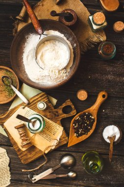 Overhead shot of vintage kitchen utensils and ingredients for cooking or baking