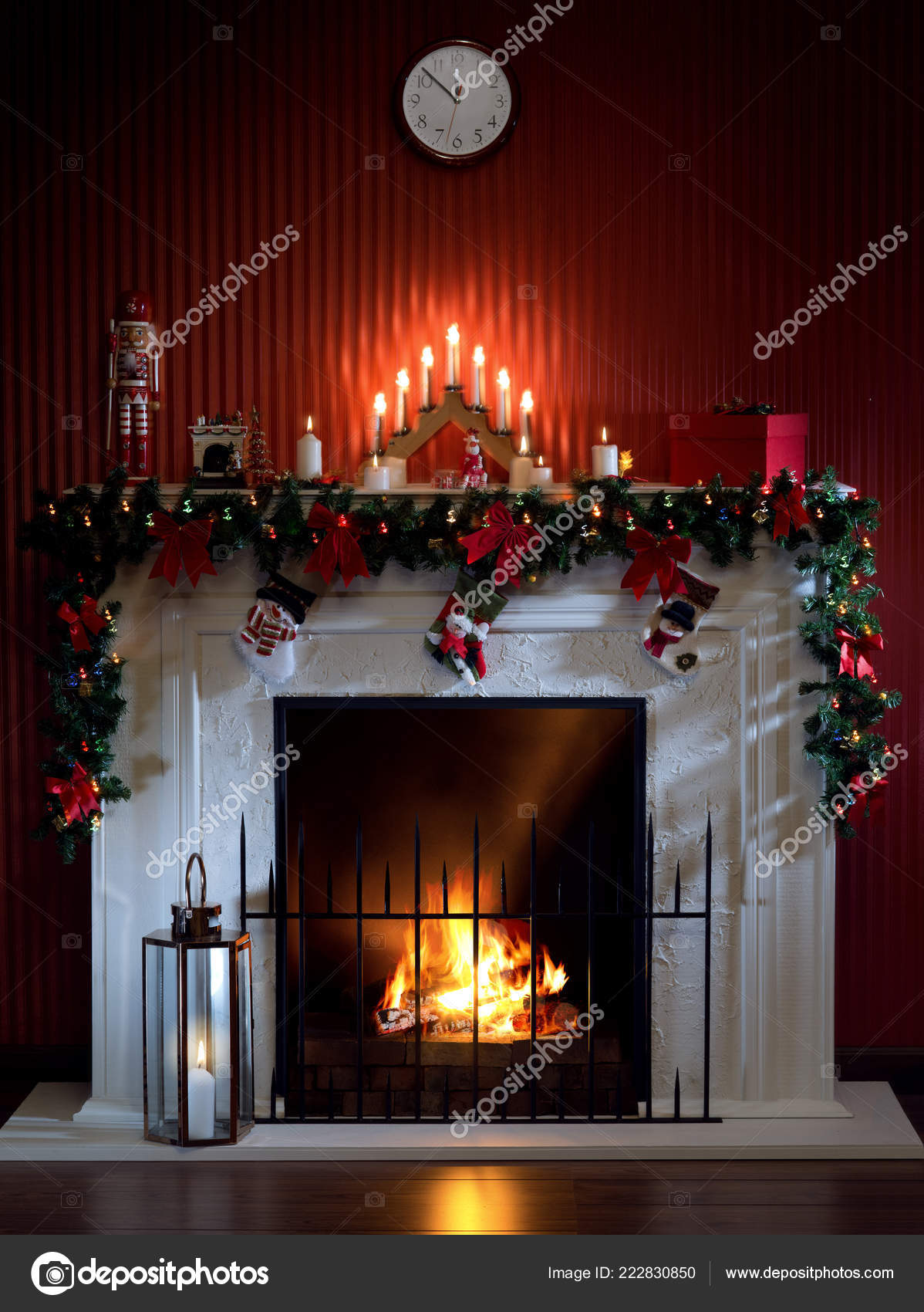 View Nice White Christmas Decorated Fireplace Candles Stock