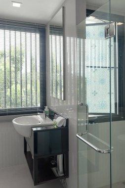 view of nice tiled modern restroom and glass shower door