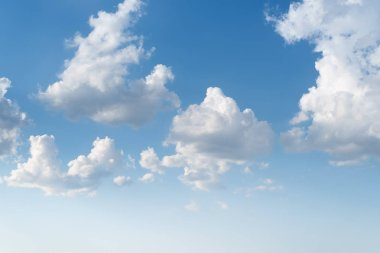 White cumulus clouds in the blue sky. Heaven for a collage