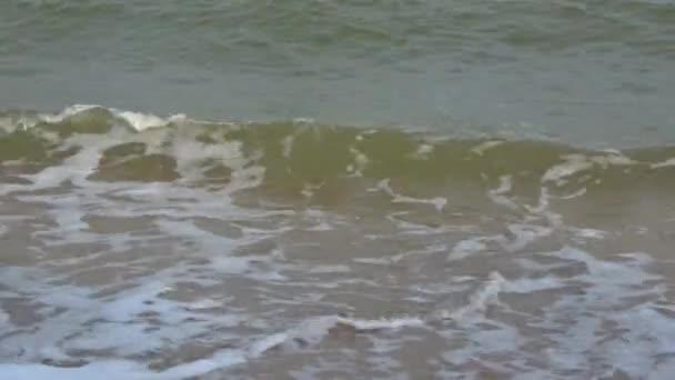 Sea waves run on the sandy shore. Gulf of Thailand, Thailand