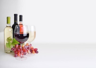 bottles of wine, wineglass and grapes