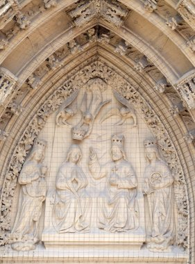 The tympanum shows the Coronation of the Virgin portal of the Marienkapelle in Wurzburg, Bavaria, Germany