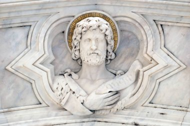 Saint John the Baptist, relief on the facade of Basilica of Santa Croce (Basilica of the Holy Cross) - famous Franciscan church in Florence, Italy