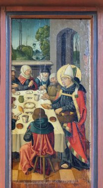 Louis is feeding poor people and pilgrims, altar of St. Louis of Toulouse in St James Church in Rothenburg ob der Tauber, Germany