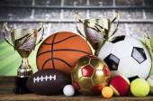 Fotografie Poháry vítězové ocenění, sportovní vybavení a míčky