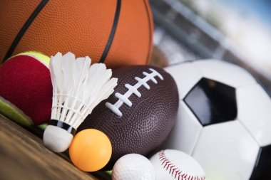 Assorted sports equipment, different kinds of balls