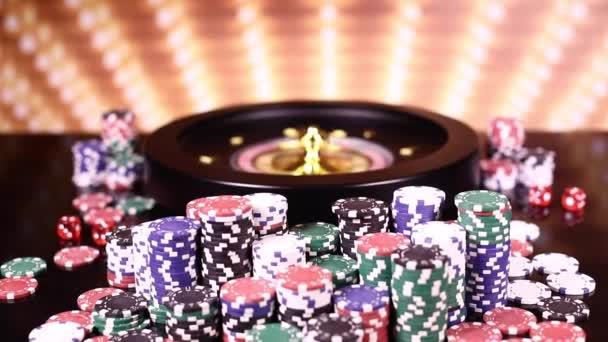 Kolo rulety v kasinu, pokerové žetony