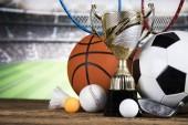 Fotografie Vítězný a mistrovský koncept, pohár trofeje na sportovním pozadí