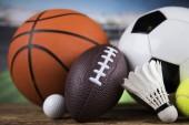Fotografie Sport equipment and balls, stadium background