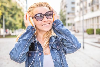 beautiful woman listening music with headphone