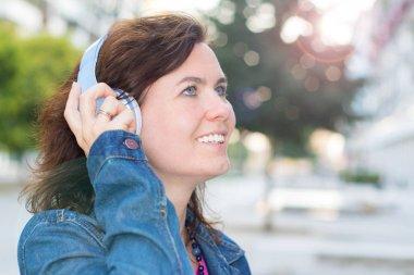 beautiful woman listening music with headphone