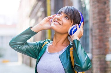 beautiful woman are listening music with headphone