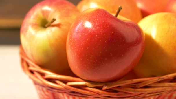 group of ripe red apples on wooden  red basket
