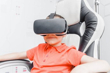 Children experiencing virtual reality in VR glasses