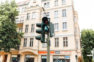 16 MAY 2018, BERLIN, GERMANY: pedestrian traffic light showing emblematic Ampelmann man