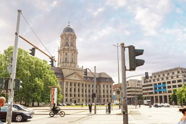 17 MAY 2018, BERLIN, GERMANY: Busy city street with traffic jam and pedestrians at the background of Altes Stadthaus or Old Town Hall