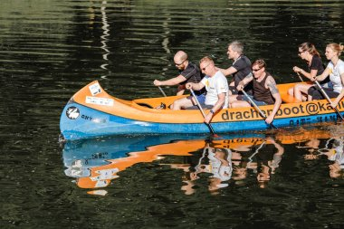 22 MAY 2018, LEIPZIG, GERMANY: Group of happy people in a kayak boat