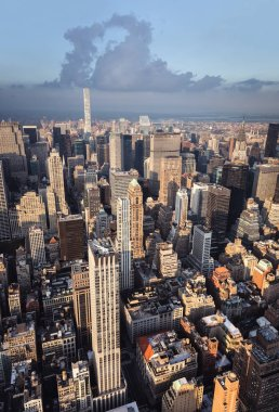 NEW YORK, USA - Sep 17, 2017: Streets and roofs of Manhattan in sun light. New York City Manhattan midtown viewed from top of Empire State Building. Birds eye view