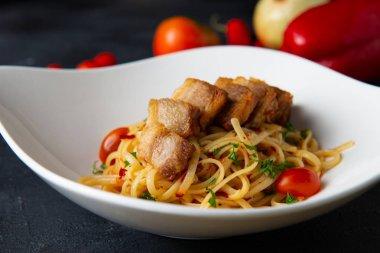 close-up shot of crispy Pork belly spaghetti