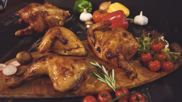 close-up footage of roasted chicken on a wooden board