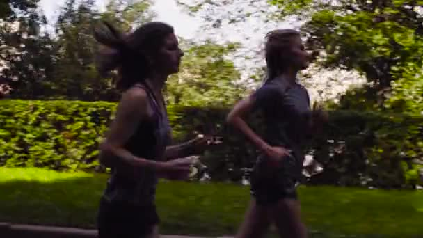 Two women running in the city near the river