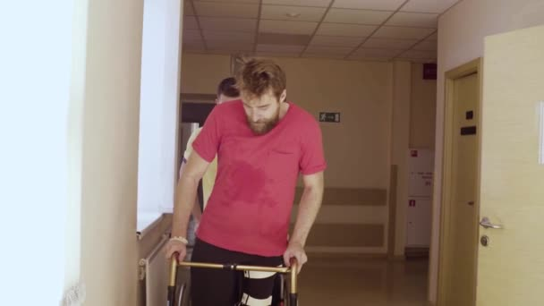 Face of disabled man in orthosis walking with a walking frame