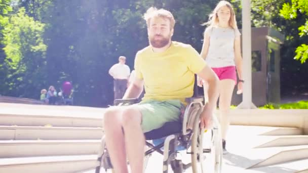 Disable man in a wheelchair riding down the inclined plane