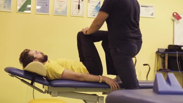 Doctor helping disabled sportsman at the rehabilitation center