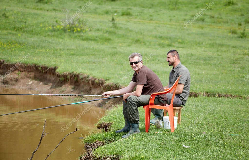 Friends fishing in a lake and having a good time