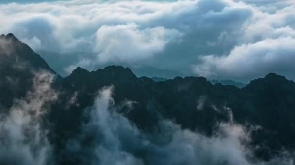 Clouds over mountain ridges at blue hour, timelapse