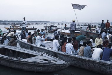 VARANASI, UTTAR PRADESH, INDIA - JULY 7, 2018: Pilgrims bathing and performing ritual at the water holy Ganges river