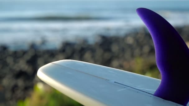 Surf board close up on blur beach coast background