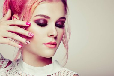 Blonde Girl with Elegant and shiny Hairstyle. Beautiful Model Woman with Curly Hairstyle. Care and Beauty Hair products. Nails and Manicure