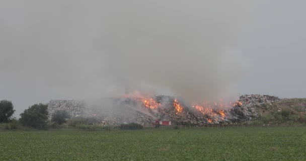 Firefighters at Garbage Dump With Heavy Smoke Pollution Landfill Fire