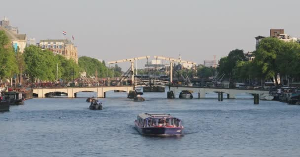 Amsterdam, Netherlands - May 14, 2018: Famous Skinny Bridge Magere Burg Over Amstel River in Amsterdam, Netherlands.
