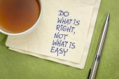 Do what is right, not what is easy  advice or reminder - handwriting on a napkin with a cup of tea