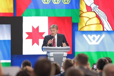 MOSCOW, RUSSIA - DEC 23, 2016: The Dmitry Sergeyevich Peskov - Press Attache for the President of Russian Federation Vladimir Putin, Deputy head of the Presidential at annual press conference in Center of international trade