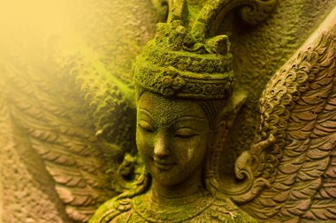 Statue of Sandstone, Goddess, Goddess, artwork according to the belief of Hinduism. Hindu Brahman India, Sri Lanka, Myanmar, Thailand, Laos, Cambodia, Indonesia    is located outdoors and has grass moss green.