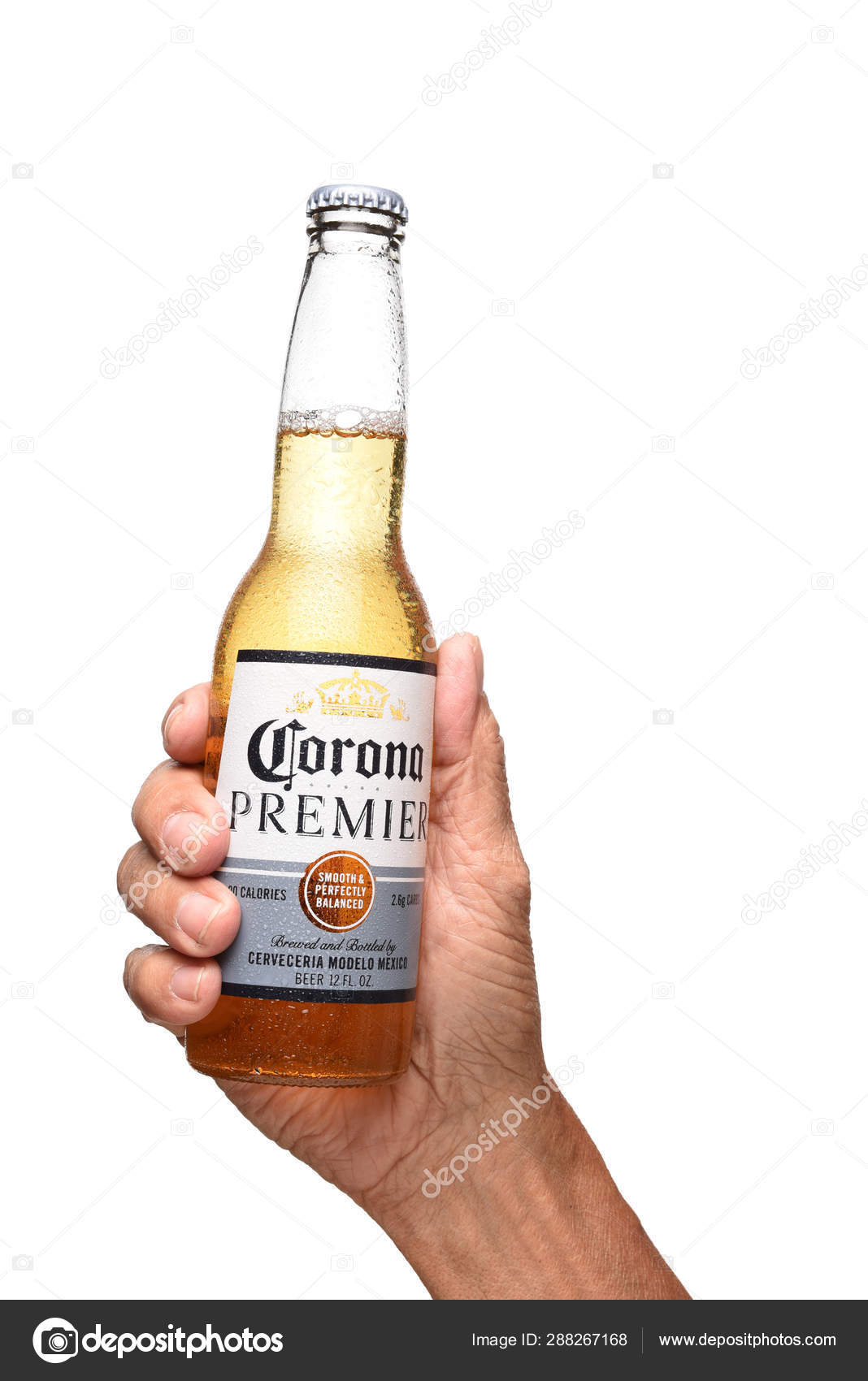 A Hand Holding A Bottle Of Corona Premier Lager Over White Stock Editorial Photo C Scukrov 288267168