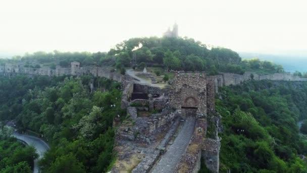 Aerial sunrise view of Tsarevets Fortress in Veliko Tarnovo in a beautiful summer day, Bulgaria 2018.