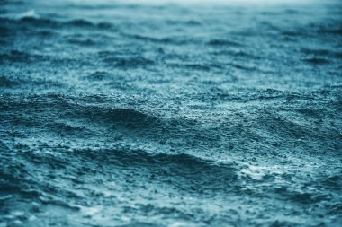 Rain over the sea waves, natural background. Ripple water